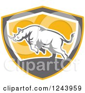 Clipart Of A Retro Angry Rhinoceros Charging In A Shield Royalty Free Vector Illustration