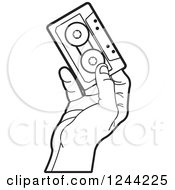 Clipart Of A Black And White Hand Holding A Cassette Tape Royalty Free Vector Illustration by Lal Perera