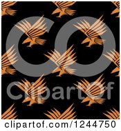 Clipart Of A Seamless Pattern Background Of Orange Eagles On Black Royalty Free Vector Illustration