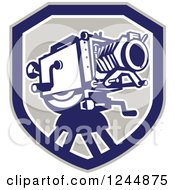 Clipart Of A Retro Movie Camera In A Shield Royalty Free Vector Illustration
