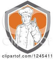 Clipart Of A Retro Male Chef Holding Up A Finger In A Shield Royalty Free Vector Illustration