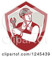 Clipart Of A Retro Male Worker Holding A Spanner Wrench In A Shield Royalty Free Vector Illustration