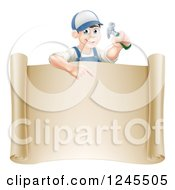 Happy Brunette Worker Man Holding A Hammer And Pointing Down At A Scroll Sign
