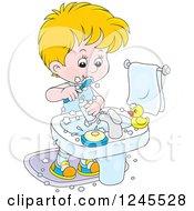 Blond Boy Brushing His Teeth In A Bathroom
