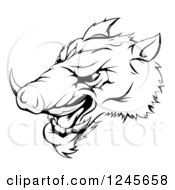 Clipart Of A Black And White Aggressive Razorback Boar Sports Mascot Royalty Free Vector Illustration by AtStockIllustration