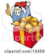 Blue Postal Mailbox Cartoon Character Standing By A Christmas Present