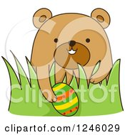 Clipart Of A Brown Bear With An Easter Egg In Grass Royalty Free Vector Illustration by BNP Design Studio
