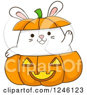Clipart Of A White Bunny Rabbit Waving In A Halloween Jackolantern Royalty Free Vector Illustration