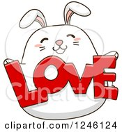 Clipart Of A White Bunny Rabbit Holding LOVE Royalty Free Vector Illustration