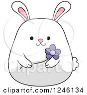 Clipart Of A White Bunny Rabbit Holding A Purple Flower Royalty Free Vector Illustration