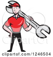Clipart Of A Cartoon Male Mechanic With A Giant Spanner Wrench Royalty Free Vector Illustration