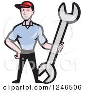 Clipart Of A Cartoon Male Mechanic Standing With A Giant Spanner Wrench Royalty Free Vector Illustration