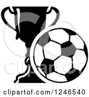Clipart Of A Black And White Soccer Ball And Trophy Cup Royalty Free Vector Illustration