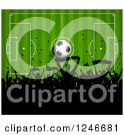 Clipart Of A Silhouetted Crowd Of Fans Over A Soccer Pitch Royalty Free Vector Illustration by KJ Pargeter