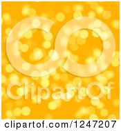 Clipart Of A Glittery Orange And Yellow Blurred Bokeh Dot Background Royalty Free Illustration