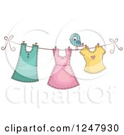 Clipart Of Girls Clothing Hanging On A Clothesline With A Bird Royalty Free Vector Illustration