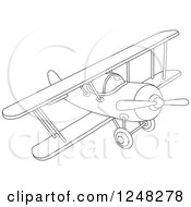 Clipart Of A Black And White Biplane Flying Royalty Free Vector Illustration
