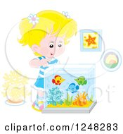 Blond Caucasian Girl Looking Into A Fish Tank