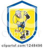 Clipart Of A Cartoon Male Hockey Player In Blue And Yellow In A Shield Royalty Free Vector Illustration by patrimonio