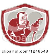 Clipart Of A Retro Woodcut Welder In A Shield Royalty Free Vector Illustration