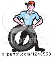 Clipart Of A Cartoon Mechanic Worker With A Tire Royalty Free Vector Illustration by patrimonio