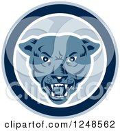Clipart Of A Retro Woodcut Panther Face In A Circle Royalty Free Vector Illustration