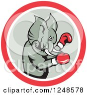 Clipart Of A Cartoon Republican Elephant Boxing In A Circle Royalty Free Vector Illustration by patrimonio