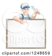 Happy Brunette Mechanic Man Holding A Spanner Wrench And Pointing Over A White Board Sign