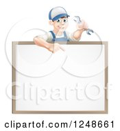 Happy Brunette Mechanic Man Holding A Wrench And Pointing Over A White Board Sign