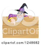 Senior Male Wizard Pointing Down At A Wooden Sign