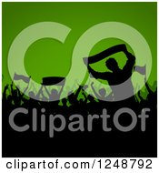 Clipart Of A Black Silhouetted Crowd Of Soccer Fans Over Green Royalty Free Vector Illustration