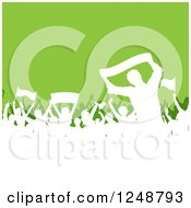 Clipart Of A White Silhouetted Crowd Of Soccer Fans Over Green Royalty Free Vector Illustration