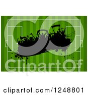 Clipart Of A Silhouetetd Splatter Soccer Fan Crowd Over A Field Royalty Free Vector Illustration by KJ Pargeter