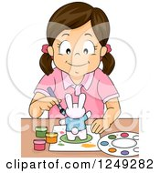 Clipart Of A Creative Brunette Girl Painting A Rabbit Figurine Royalty Free Vector Illustration by BNP Design Studio