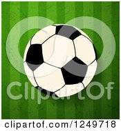 Football Soccer Ball Over Distressed Green Stripes