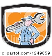 Clipart Of A Cartoon Male Plumber Carrying A Wrench In A Black White And Orange Shield Royalty Free Vector Illustration