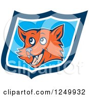 Clipart Of A Cartoon Happy Fox Face In A Blue Shield Royalty Free Vector Illustration by patrimonio