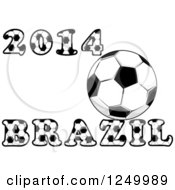 Clipart Of A Soccer Ball And 2014 Brazil Text Royalty Free Vector Illustration