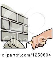 Clipart Of A Mason Hand Laying Bricks 2 Royalty Free Vector Illustration
