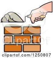 Clipart Of A Mason Hand Laying Bricks Royalty Free Vector Illustration