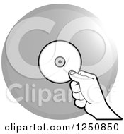 Clipart Of A Black And White Hand Holding A Cd Over A Silver Circle Royalty Free Vector Illustration