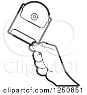 Clipart Of A Black And White Hand Holding A Cd Royalty Free Vector Illustration