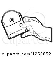 Clipart Of A Black And White Hand Holding A Cd In A Sleeve Royalty Free Vector Illustration