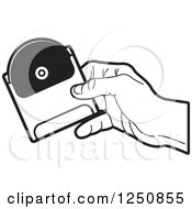 Clipart Of A Black And White Hand Holding A Dvd Or Cd In A Sleeve Royalty Free Vector Illustration