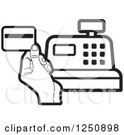 Clipart Of A Black And White Hand Holding A Credit Card Over A Cash Register Royalty Free Vector Illustration by Lal Perera