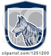 Clipart Of A Retro Woodcut German Shepherd Dog In A Gray And Blue Shield Royalty Free Vector Illustration