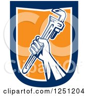 Retro Woodcut Hand Holding Up A Spanner Wrench In A Blue White And Orange Shield