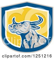 Clipart Of A Retro Bull In A Blue And Yellow Royalty Free Vector Illustration by patrimonio
