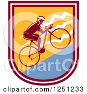 Clipart Of A Retro Cyclist Man Riding Uphill In A Shield Royalty Free Vector Illustration