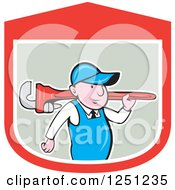 Clipart Of A Cartoon Male Plumber Carrying A Giant Monkey Wrench In A Shield Royalty Free Vector Illustration
